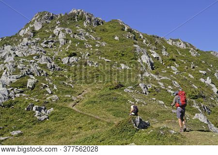 Prabert, France, July 20, 2020 : Walkers On Mountain Paths. Belledonne Mountain Range Is Noted For T