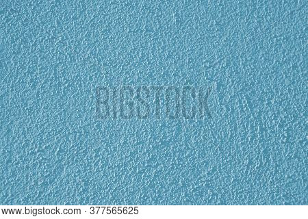 A Low-contrast, Blue Plaster Wall With A Rough Surface, An Abstract Background Image For Design Crea