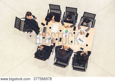 Team Leader Encourages People In Team At Meeting Table . Executive Manager Gives Command To Office W