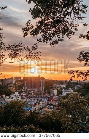 Kyiv, Ukraine - June 6, 2020: Beautiful Panorama Of Kyiv With Dramatic Orange Sunset And Clouds.