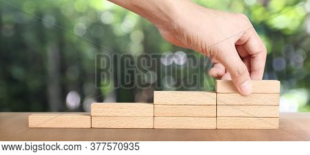 Hand Arranging Wood Block Stacking As Step Stair, Business Concept Growth Success Process