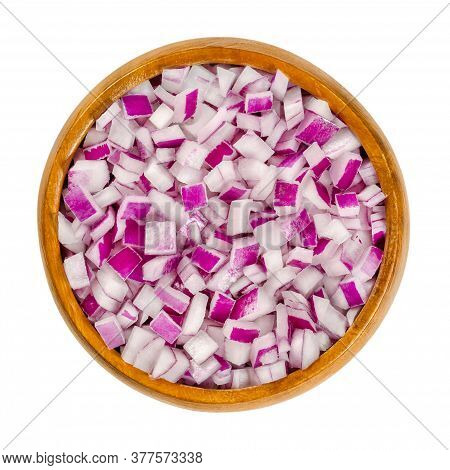 Diced Red Onions In Wooden Bowl. Cut Cubes Of Onion Cultivar Allium Cepa, With Purplish Red Skin And