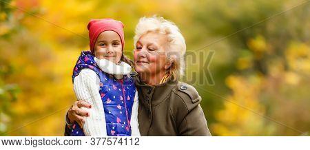 Senior Citizen Stroll In A Park In Autumn