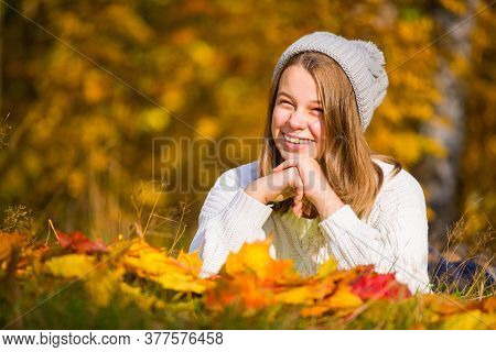 Portrait Of Pretty Nice Teenage Girl With Dental Braces In Autumn Park , Background With Copy Space
