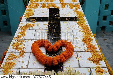 Tomb of a Croatian missionary, Jesuit father Ante Gabric, decorated on the occasion of his 105th birthday in Kumrokhali, West Bengal, India