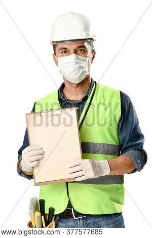 Manual worker wearing protective face mask and gloves to avoid Coronavirus epidemic holds clipboard isolated on white background.