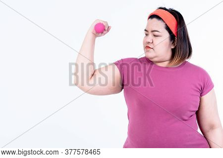 Asian Fat Woman Exercising, Lifting Weights With Dumbbells, To Lose Weight And To Keep Healthy And H