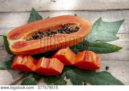 Slices Piece Of Sweet Papaya Fruit On Wooden Table.