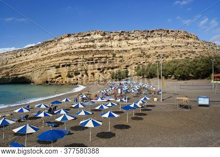 Matala, Crete / Greece / October 15 2010 : Holiday Makers Enjoy The Late Summer Sunshine On The Beac