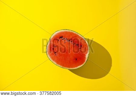 Large Juicy, Red Watermelon On A Yellow Background. Summer Backgrounds Concept. Fresh Berries. Free