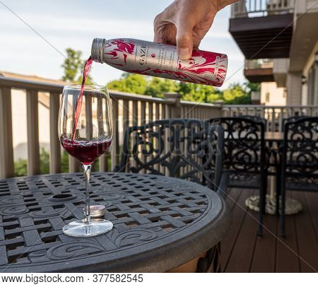 Morgantown, Wv - July 15, 2020: Gaze Red Wine Cocktail Being Poured Into Wine Glass On Outdoor Patio