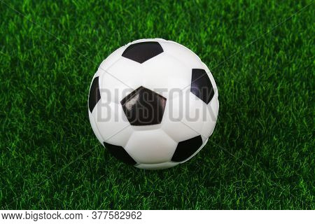 Traditional Soccer Ball On Soccer Field. Football Ball On A Green Grass Stadium Football Field, Game