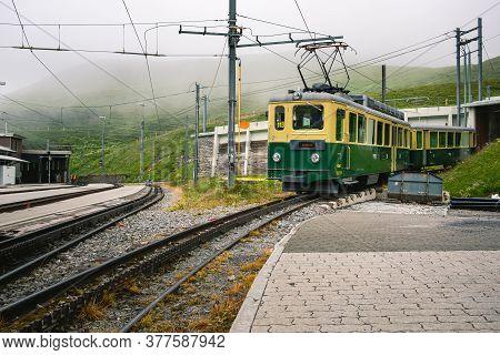 Kleine Scheidegg, Bernese Oberland, Switzerland - July 31 2019 : Old Electrical Green And Yellow Tra