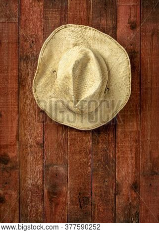 old straw cowboy hat weathered wooden barn wall, copy space