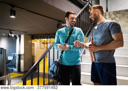 Sport, Fitness, Friends, Lifestyle Concept. Smiling Men Friends Talking After Workout In Gym