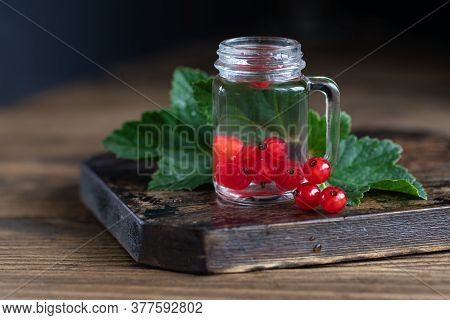 Homemade Liqueur In Shot Glass With Red Current Berries On The Table. Fruit Flavor Alcohol Drink Wit