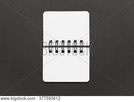 Open Notebook On A Black Background, Minimal Design