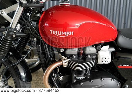 Bordeaux , Aquitaine / France - 07 17 2020 : Triumph Motorcycle Detail Sign Logo On Red Fuel Tank On