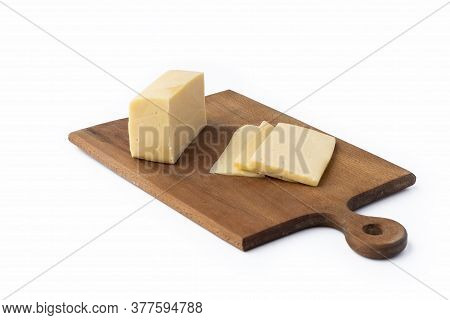On A White Background. No Isolation. A Small Piece Of Cheese Is Cut Into Wedges. And A Kitchen Knife