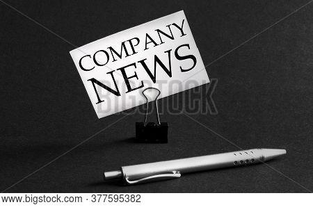 White Paper With Text Company News On A Black Background With Stationery