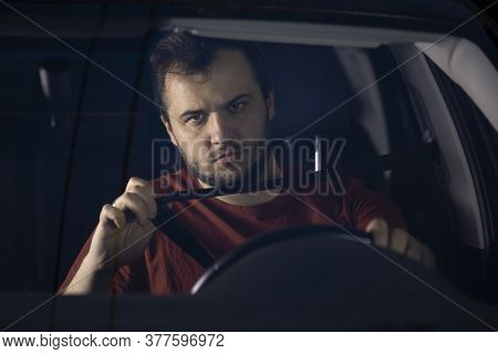 A Young Bearded Man Fastens His Seat Belt In A Car. Safe Driving. Responsible And Law Abiding Driver