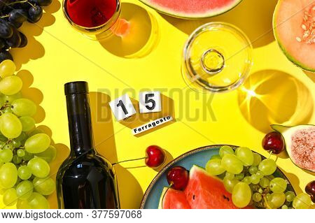 Grapes, A Bottle Of Wine And Different Fruits On A Yellow Background. English Text August 15, Tradit