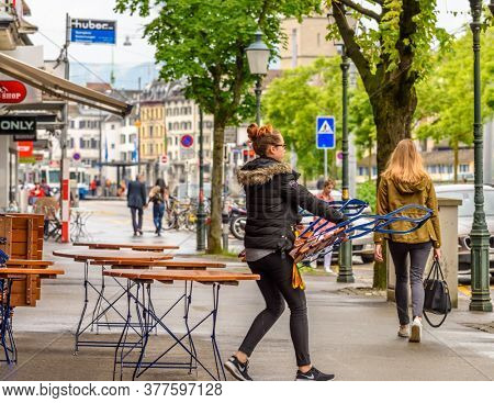 ZURICH, SWITZERLAND, MAY 30, 2016: TOURISTS ON THE STREETS IN THE OLD HISTORICAL CENTER OF ZURICH.