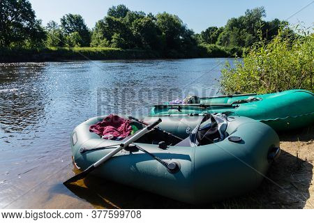 Inflatable Boat On The Background Of The River And Nature. Travel Concept, Rafting, Rafting.