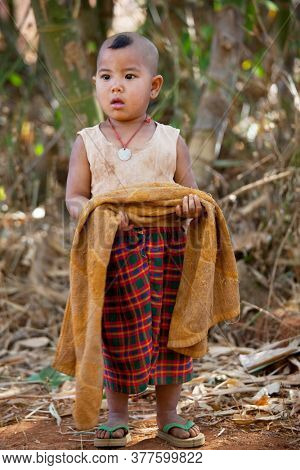 INLE LAKE, MYANMAR - FEBRUARY 2, 2011: Unidentified Pa-O tribe boy in traditional colourful clothing in Inle lake area, Shan State, Myanmar (Burma).