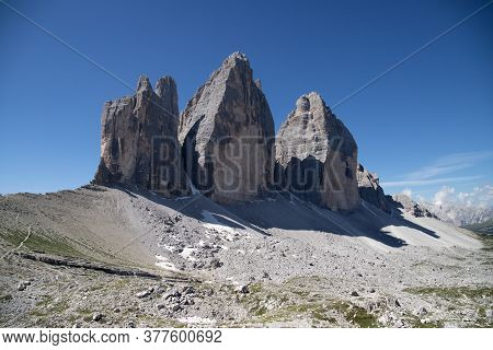 Three Towers Of The Lavared Massif Of The Italian Dolomites On A Background Of Blue Sky