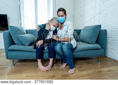 Mother And Daughter Crying At Home In Quarantine Grieving Loss Of Family Members Amid Covid-19