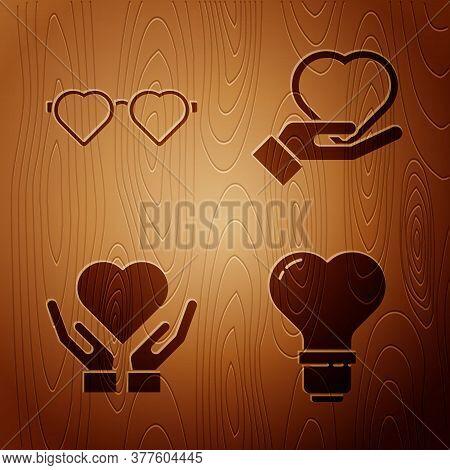 Set Heart Shape In A Light Bulb, Heart Shaped Love Glasses, Heart On Hand And Heart On Hand On Woode
