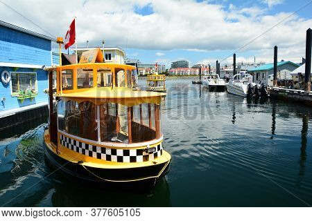 Victoria Bc,canada,july 12th 2020.harbor Ferries And Taxis Run Tourists And Locals To And From Inner