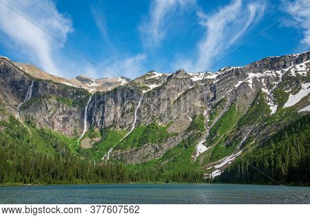 Waterfalls On Mountains In Avalanche Basin In Glacier National Park.