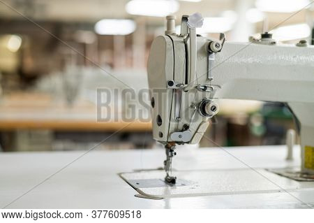 Interior Of A Workshop For Sewing Clothes And Textiles. Without People. The Workroom Of Seamstresses