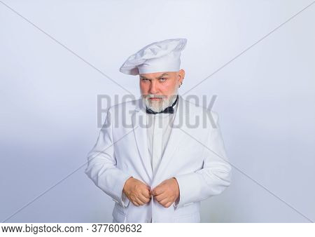 Male Chef In White Uniform. Cooking. Serious Chef In Uniform. Old Bearded Cook. Cooking Concept. Pro