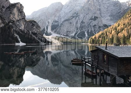 Lake Lago Di Braies In Dolomiti Mountains, South Tyrol, Italy. Dock With Romantic Old Wooden Rowing