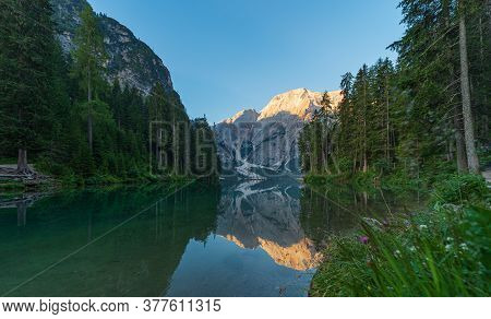 The Mountain Lake Of Braies Immersed In The Green Of South Tyrol, In The Background The Seekofel