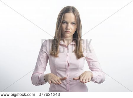 Serious Looking Confident Bossy Woman Trying Calm Down Person In Panic, Raise Hands Soothing Calming