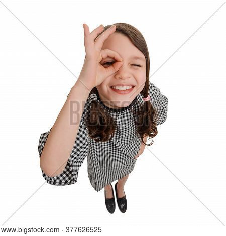 Girl Looking Through Alright Hand Sign On White