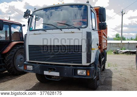 An Old Truck Truck Drives Along The Citys Street Road