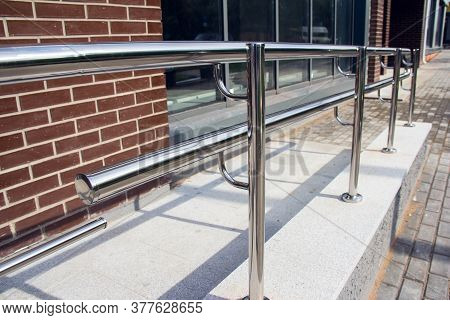 Stainless Steel Railings. Chromed Metal Railings. Shiny Chrome Metal Fencing And Railings. Handrail,