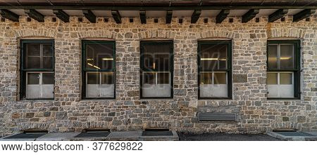 Series Of Windows Lined Up On A Building Of Clear Stones, Mountain Architecture