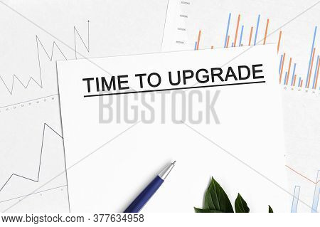 Time To Upgrade Document With Graphs, Diagrams And Blue Pen