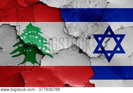 Flags Of Lebanon And Israel Painted On Cracked Wall