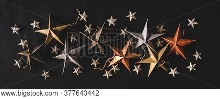 Christmas Decorative Toy Small And Big Stars Over Black Background