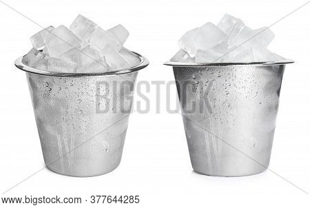 Metal Buckets With Ice Cubes On White Background