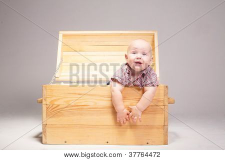Child In A Wooden Box