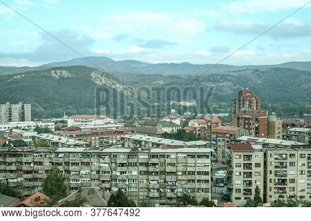 Panorama Of North Mitrovica, The Serbian Part Of The Town, With Crumbling Residential Buildings, It