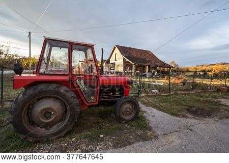 Kraljevo, Serbia - November 10, 2019: Tractor In Front Of A Farm In The Countryside Of Serbia, In A